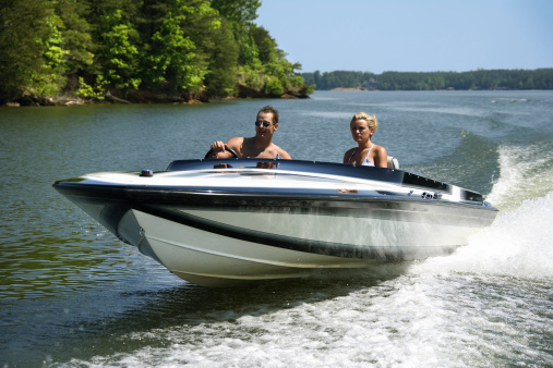 couple speed boat on water